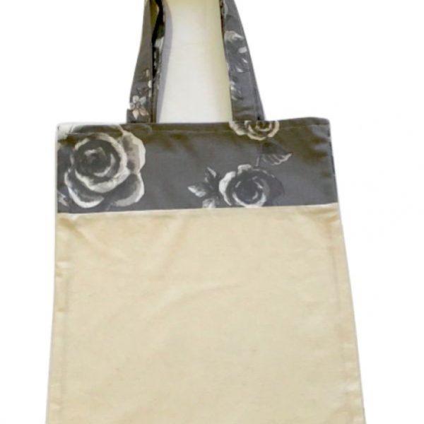 Bolsa para zafú bicolor con asas grises y flores blancas