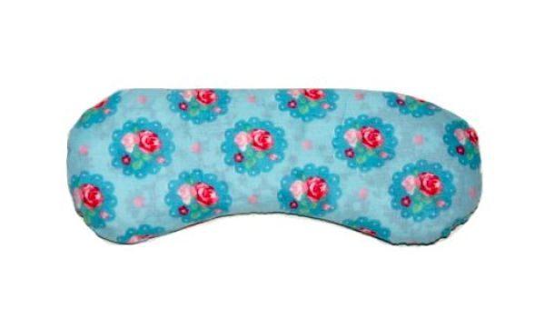 Almohadilla para los ojos azul con flores rosas